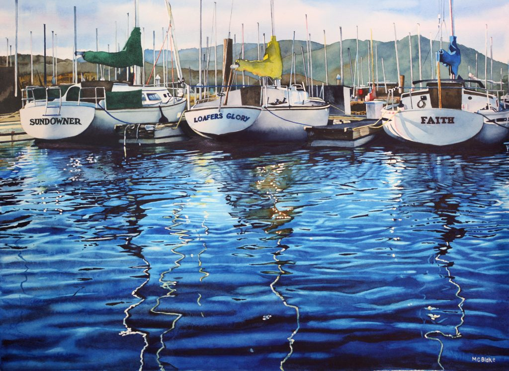 Back ends of sail boats reflected in water
